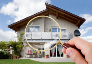 magnify glass in front of a house