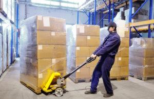 worker using machine skates in warehouse